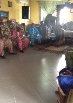 The Wocon Team (kneeling) Taking Pictures with High Chief Dr. Owheton Ahunbe II